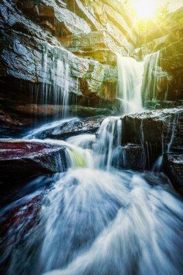 Adesivo Cachoeira tropical com raios de sol