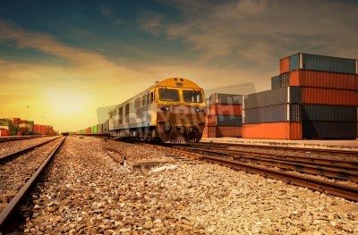 Adesivo Cargo train platform at sunset with container