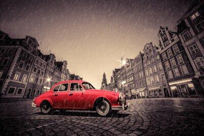 Adesivo Carro vermelho retro na cidade velha histórica do cobblestone na chuva. Wroclaw, Poland.