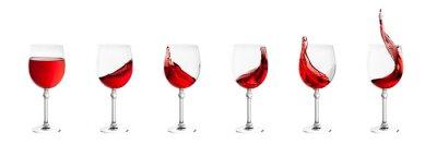 Adesivo Conjunto de copos de vinho com salpicos de vinho isolado no branco de volta