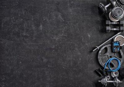 Adesivo Equipamento desportivo em um fundo preto. Vista do topo. Motivação