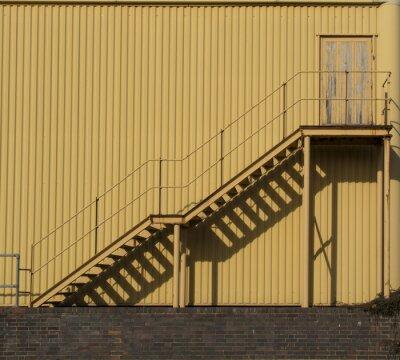 Adesivo Escadas que conduzem através de uma parede metálica do sidinf.