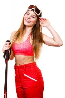 Adesivo Esquiador da mulher nos googles com pólos de esqui. Esporte de inverno