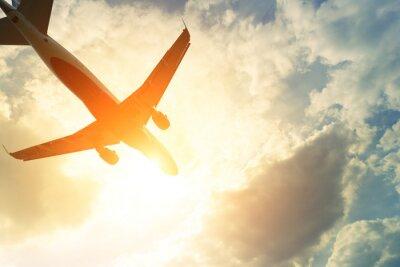 Adesivo Foto tonificada de avião comercial no sol