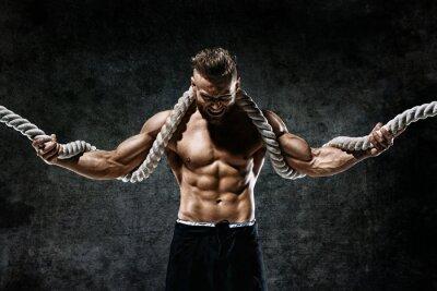 Adesivo Homem musculoso com corda. Foto do homem com corpo perfeito após o treino. Estilo fashion