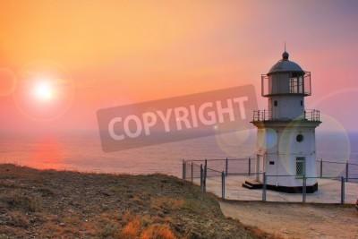 Adesivo Lighthouse on the coast at dawn
