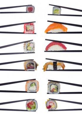 Adesivo Many sushi rolls in chopsticks isolated on white background