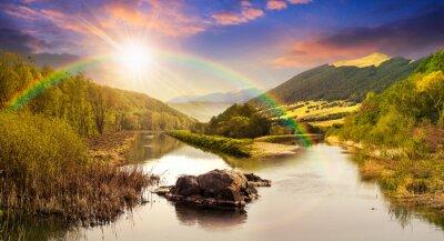 Adesivo rio da floresta com pedras e grama no por do sol