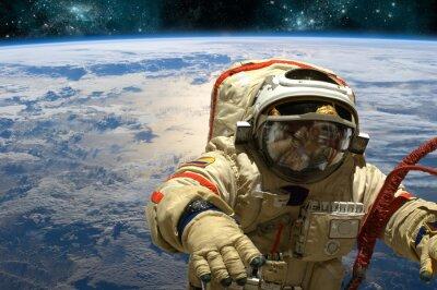 Adesivo Um cosmonauta flutua no espaço. - Elementos desta imagem fornecidos pela NASA.