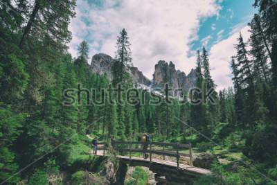 Adesivo wooden bridge and saent waterfall on italian alps, Ambrizola mountains in Dolomites