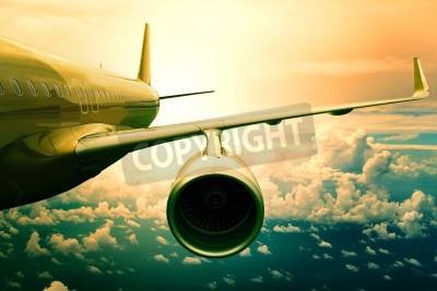 Fotomural avião a jato de passageiros voando acima uso scape nuvem para o transporte aeronaves e viajar fundo negócio