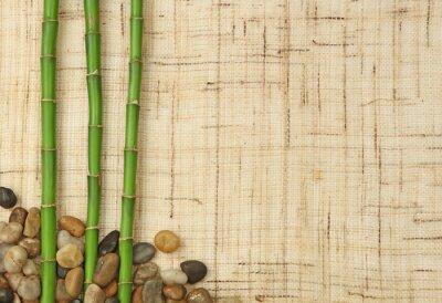 Fotomural bambou et cailloux sur fond de toile de juta