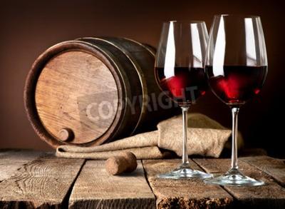 Fotomural Barril e copos de vinho tinto em uma mesa de madeira