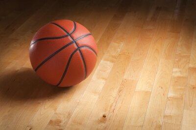 Fotomural Basketball on hardwood court floor with spot lighting