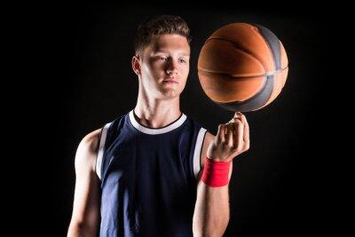 Fotomural Basketball player spinning ball on finger