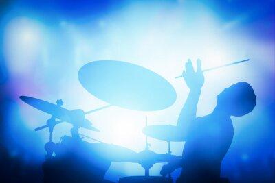 Fotomural Baterista que joga na bateria no concerto da música. Luzes de clube