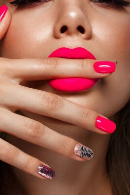 Fotomural Beautiful young woman with bright makeup and neon pink nails. Beauty face. Photo taken in the studio