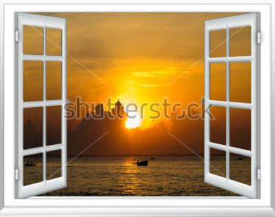 Fotomural belo pôr do sol na vista para o mar a partir da janela com cortinas abertas
