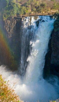 Fotomural Cataratas Vitória. Uma vista geral de um arco-íris. Parque Nacional. Mosi-oa-Tunya Parque nacional. E Património Mundial. Zambiya. Zimbábue. Uma excelente ilustração.