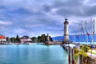 Fotomural Com vista para o porto na ilha de Lindau, no Lago Constança, no sul da Alemanha com o seu farol histórico.