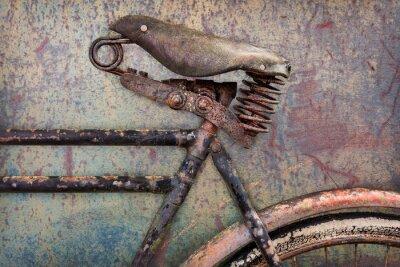 Fotomural Detalhe de uma bicicleta enferrujada antiga com assento de couro