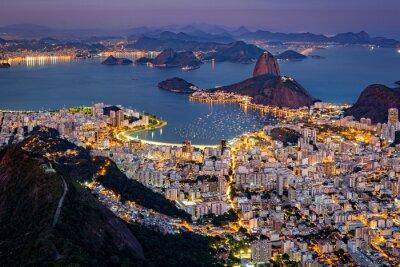 Fotomural Espetacular vista aérea sobre o Rio de Janeiro como visto do Corcovado. O famoso Pão de Açúcar fura para fora da Baía de Guanabara