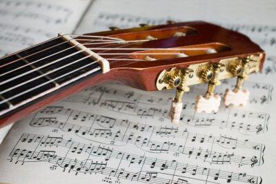 Fotomural estoque cabeça da guitarra em notas musicais