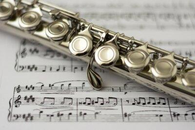 Fotomural Feche acima da flauta na flauta fundo da partitura