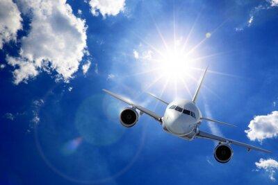 Fotomural Flugzeug em Sonne und Wolken