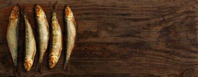 Fotomural herring sprats smoked wooden oak background