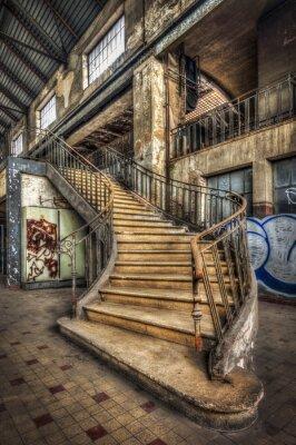 Fotomural Imponente escadaria dentro do salão de uma usina abandonada