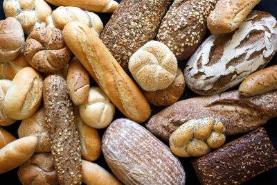 Fotomural Muitas madeiras pães e pãezinhos de tiro de cima.