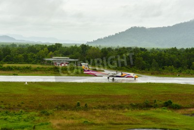 Fotomural Nok air Bombardier Dash 8 q 400 aircraft type take off for taxi at ranong airport in rainy day june 172558.