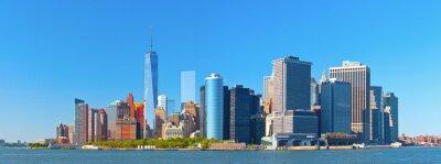 Fotomural Nova York edifícios distrito financeiro de Wall Street Lower Manhattan em um belo dia de verão com céu azul