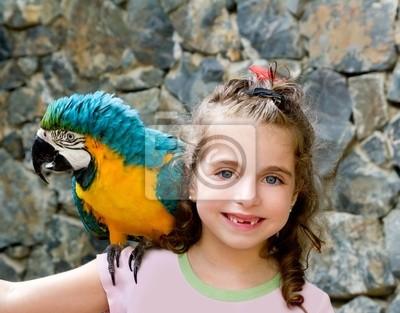 2fdec17a1e1ee Olhos azuis da menina da criança com o papagaio amarelo fotomural ...