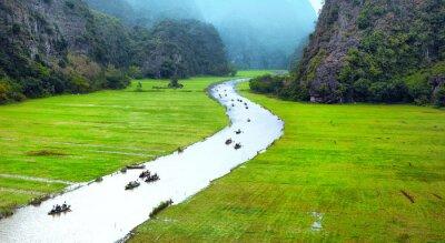 Fotomural Paisagem do curso de Vietnam. Rio torcido e montanhas de Tam Coc Ninh Binh