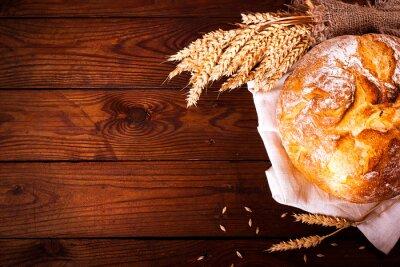 Fotomural Pão caseiro no fundo de madeira. Estilo de país. Fundo do cozimento do alimento
