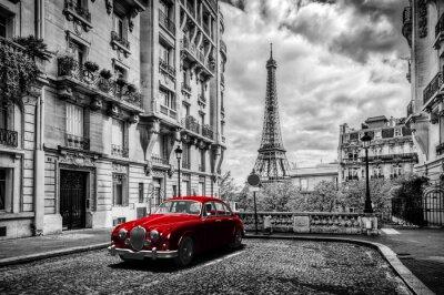 Fotomural Paris artístico, France. Torre Eiffel vista da rua com o carro retro vermelho da limusina.