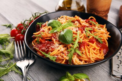 Fotomural Plate of delicious spaghetti Bolognaise or Bolognese with savory minced beef and tomato sauce garnished with parmesan