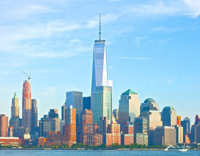 Fotomural Skyline de New York City Lower Manhattan edifícios do distrito financeiro de Wall Street em um belo dia de verão com céu azul