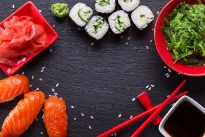 Fotomural Sushi e rolos em uma tabela de ardósia