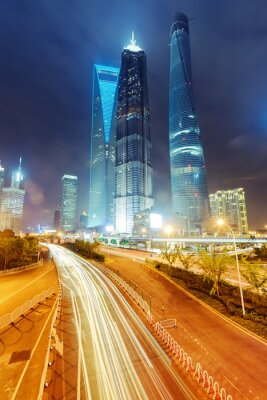 Fotomural the light trails on the modern building background in shanghai c