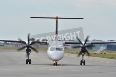 Fotomural This is a view of Eurolot plane Bombardier Dash-8 Q400 registered as SP-EQC on the Warsaw Chopin Airport. July 30, 2015. Warsaw, Poland.