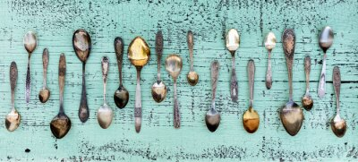 Fotomural Vintage cutlery - spoons, forks and knives on an old wooden background.
