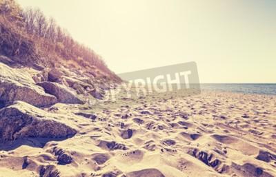 Fotomural Vintage tonificou a imagem de uma praia no por do sol.