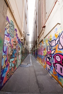 Poster Alley in Melbourne with many graffiti at the wall