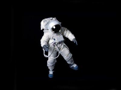 Poster Astronauta que flutua de encontro a um fundo preto.