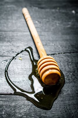 Poster Colher de madeira de mel natural doce.
