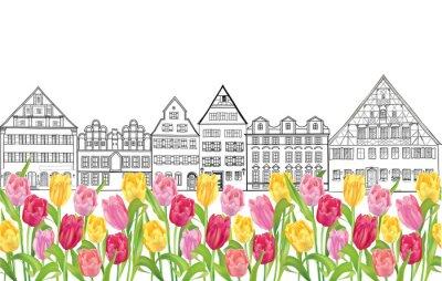 Poster Edifícios velhos e casas em Amsterdão com aléia das tulipas da flor.