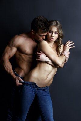 Poster Erotica. Passionate muscular guy tiras sexy girl